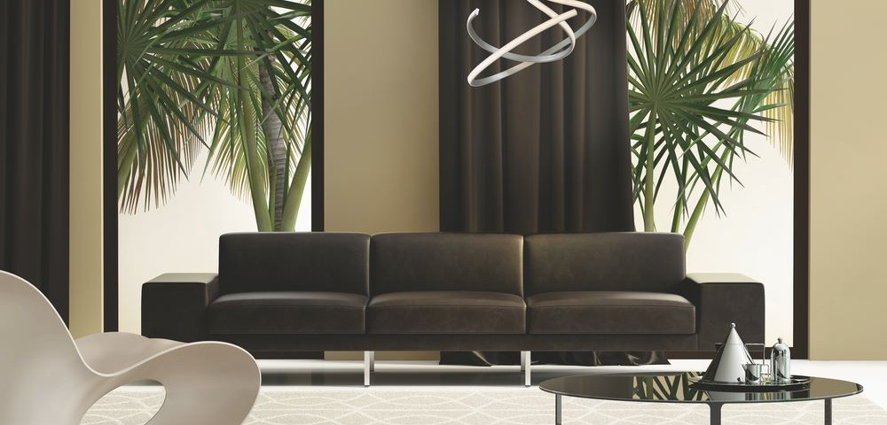 Contemporary living room with  leather sofa and a garden