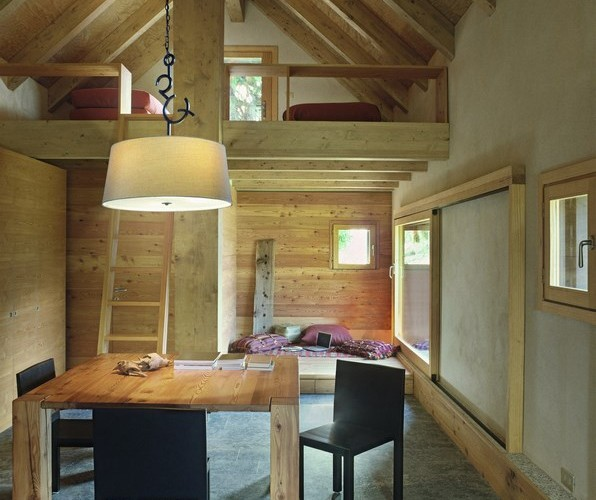 interior view of rustic living room in the rustic house with stone floor and wood ceiling